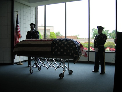 Photo of flag draped coffin of James S. Pinkney with Honor Guard