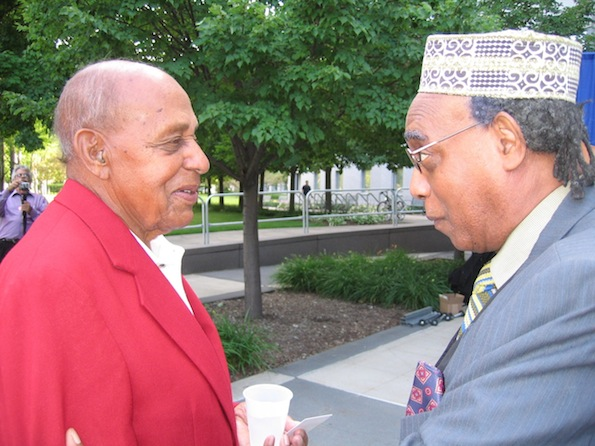 Photo of Larry Pinkney conversing Dr. Harold Brown